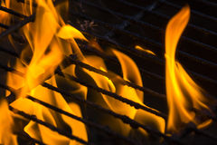 Fire on grill. A burning hot fire on grill royalty free stock photography