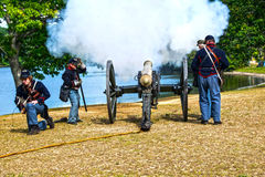 Fire. A group of men taking  part in a civil war reenactment Royalty Free Stock Photo