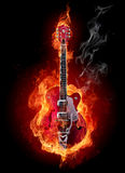 Fire guitar. Burning electric guitar isolated on black background