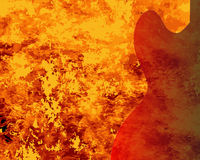Fire Guitar Background. A faded semi acoustic guitar set on a red burning background Stock Photography