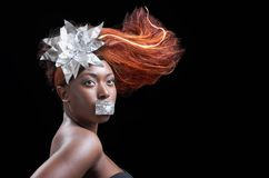 Fire in the hair. Studio portrait of a model with fiery hair Royalty Free Stock Image