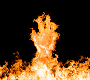 Fire hand. Rising from the fire.  on a black background Royalty Free Stock Photo