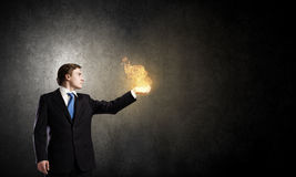 Fire in hands Stock Image