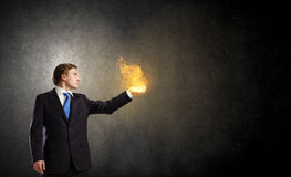 Fire in hands Royalty Free Stock Photos
