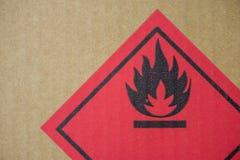 Fire hazard symbol on a cardboard box Stock Photo