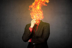 Fire Head Business Man. Over grunge background Royalty Free Stock Photos