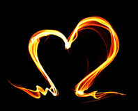 Fire heart. Orange fire heart isolated on black background Stock Image