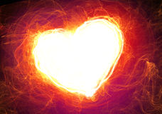 Fire heart on a black Stock Photos