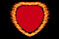 Fire heart. On the black background Royalty Free Stock Photo
