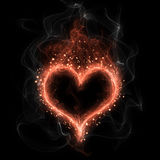 Fire heart. On dark background Stock Photo