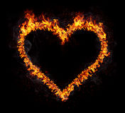 Fire Heart. Flaming heart isolated on black background. Love symbol Stock Photography