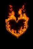 Fire heart. At night on black background Stock Image
