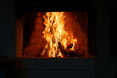 Fire in a hearth Stock Images