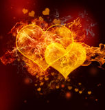 Fire Hearts. And small hearts on black background Stock Photography