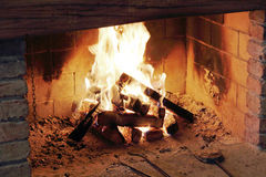 Fire. The heat of the fire with the chimney of the house Royalty Free Stock Image