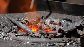 On the fire heated the workpiece for a blacksmith . stock video
