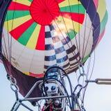 Fire heats the air inside a hot ai r balloon at balloon festival Royalty Free Stock Image