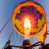 Fire heats the air inside a hot air balloon at balloon festival Stock Images