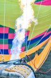 Fire heats the air inside a hot air balloon. At balloon festival stock photo