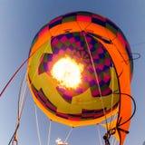 Fire heats the air inside a hot air balloon. At balloon festival royalty free stock photo