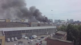 Fire. Helicopters extinguish a fire in an industrial building, Moscow, Russia stock video footage