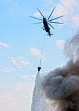 Fire helicoptrer. Fire extinguishing from the helicopter Royalty Free Stock Image