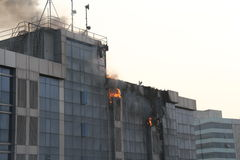 Fire in high rise building. Fire in a highrise building with glass facade royalty free stock photo