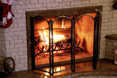 Fire in the home fireplace on Christmas night Stock Images