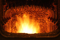 Fire in a home furnace. Fire in a home furnace Royalty Free Stock Photography