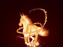 Fire Horse. A horse made of fire running, covered with a mystical fire swirl Stock Photo