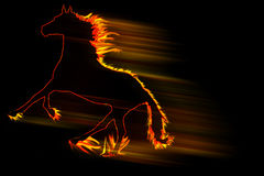 Fire horse running fast isolated on black. Horse made of fire sprinting with a motion blur Stock Photos