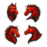 Fire horses mascots with tribal flame ornaments. Fire horses symbols of aggressive and powerful stallions with fiery red tribal pattern of flaming manes. Horse Royalty Free Stock Photo