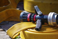 Fire hose. Yellow fire hose and nozzle Royalty Free Stock Photography