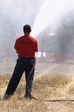 Fire hose. Man using fire hose Royalty Free Stock Photo