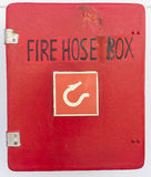 Fire hose box. Red fire hose box on ferry boat Stock Photos