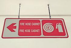 Fire hose cabinet ceiling sign royalty free stock photo