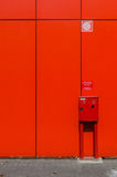 Fire hose cabinet on red wall Royalty Free Stock Photo