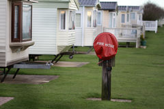 Fire hose on campsite. royalty free stock image