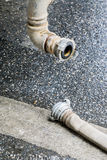 The fire hose with finnish coupler on wet road Royalty Free Stock Photos