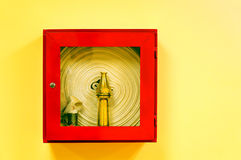 Fire hose. Fixed on the wall in a red box Royalty Free Stock Photography