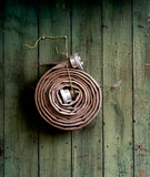 Fire hose hanging on  wooden wall Stock Photos