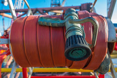 Fire hose at oil rig helipad Stock Images