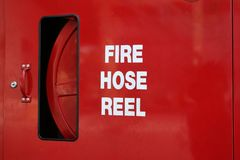 Fire Hose Reel. Bright red fire hose reel royalty free stock image