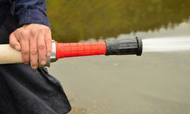 Fire hose reel Stock Photo
