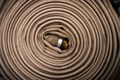 Fire hose roll. Coiled and stowed fire hose royalty free stock image