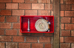 Fire hose. Roll in red box Stock Photo
