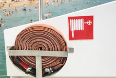 Fire hose and sign on the boat Stock Photos