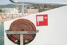 Fire hose and sign on the boat. Royalty Free Stock Photo