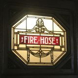 Fire Hose Stained Glass. A stained glass label for a fire hose compartment stock images