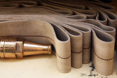 Fire hose in storage. Fire hose folded neatly in storage royalty free stock images